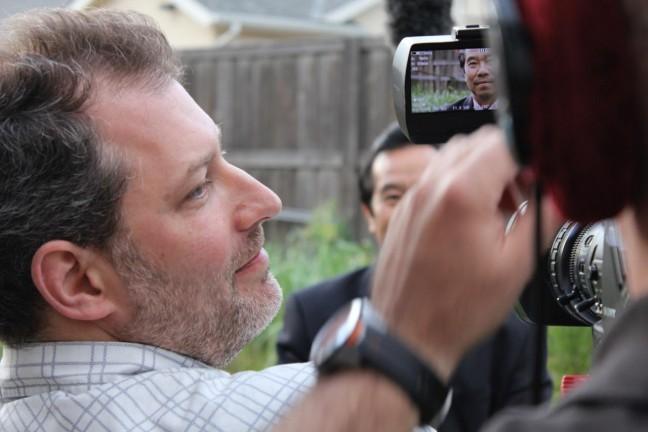 A behind-the-scenes photo of filmmaker David Grabias shooting Operation Popcorn in Fresno, CA.