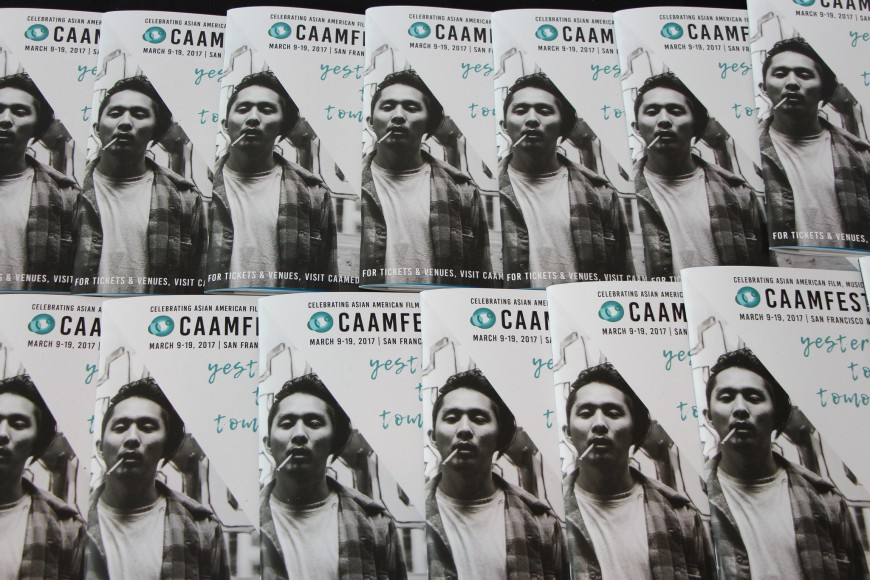 """CAAMFest 2017 program guides with Justin Chon in """"Gook"""" on the cover. Photo by Carmine Bai for CAAM."""